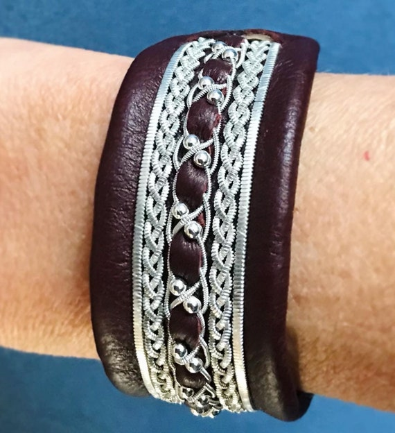 Traditional Sami leather cuffs, with pewter threads braiding and sterling silver beads.