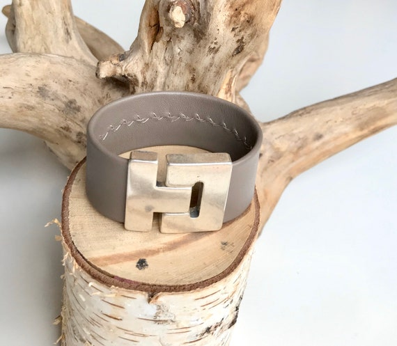 Taupe leather cuff with a magnetic clasp.
