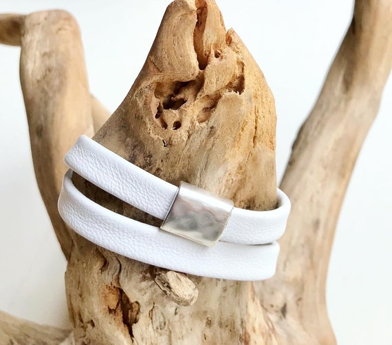 White wrap around reindeer leather bracelets with a magnetic clasps.