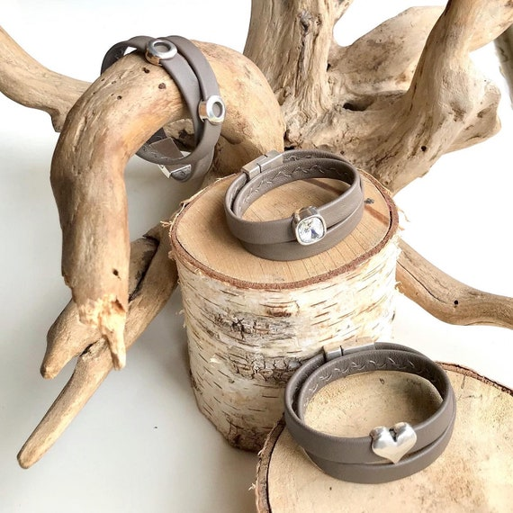 Wrap around taupe reindeer leather bracelets with a magnetic clasps.