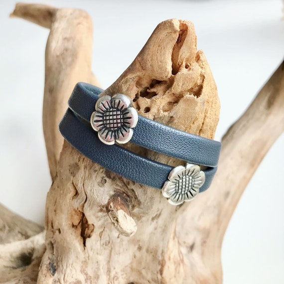 Charcoal blue wrap around reindeer leather bracelet with a magnetic clasp and two flower sliders.