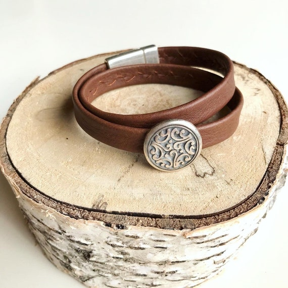 Wrap around reindeer leather bracelets with a magnetic clasp and an intricate slider.
