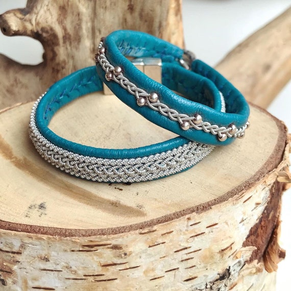 Teal reindeer leather and pewter bracelets.