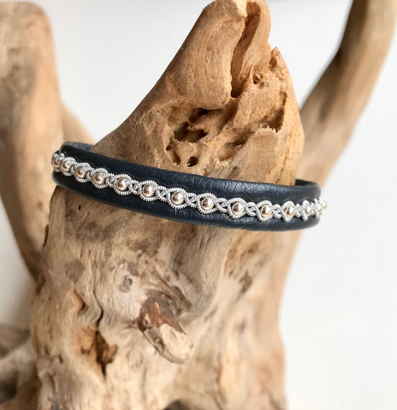 Sami charcoal reindeer leather, pewter and sterling silver beads bracelet with a magnetic clasp.