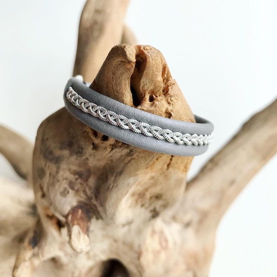 Traditional Sami mid grey reindeer leather bracelet with either an antler button or pewter button.