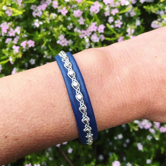 Scandinavian leather bracelets with flat rectangular sterling silver beads in a row.