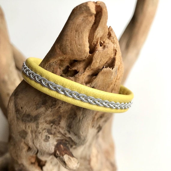 Swedish Sami yellow reindeer leather bracelet with traditional pewter braiding and pewter button.