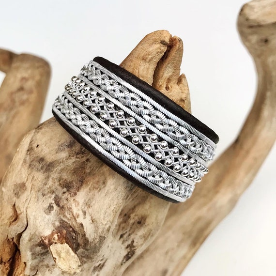 Viking leather cuffs, with flat pewter threads and sterling silver beads.