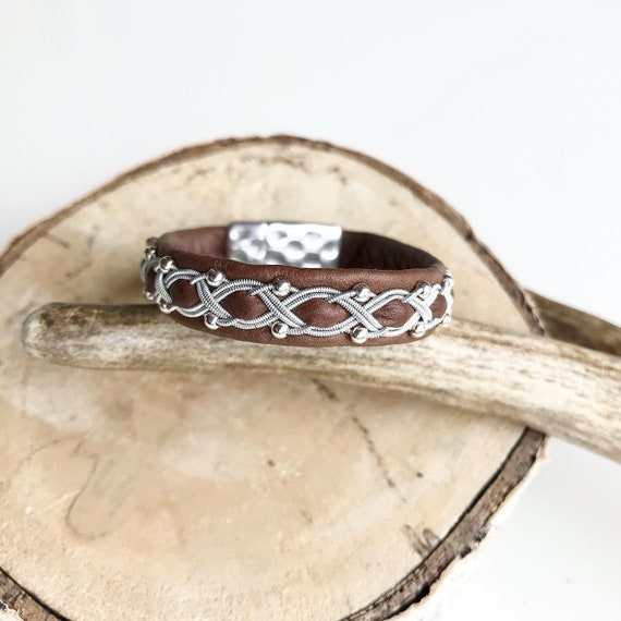 Nougat brown reindeer leather bracelet with traditional pewter braiding and sterling silver beads.