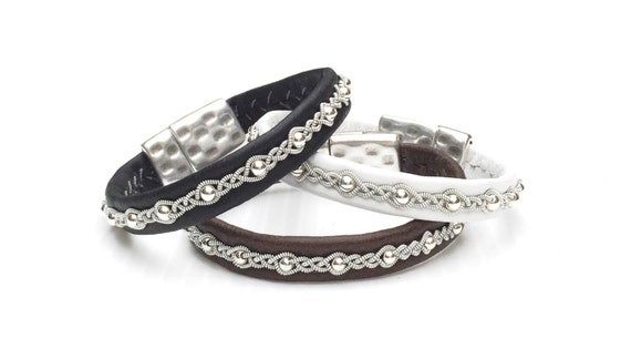 Swedish soft reindeer leather with sterling silver beads and spun pewter threads.