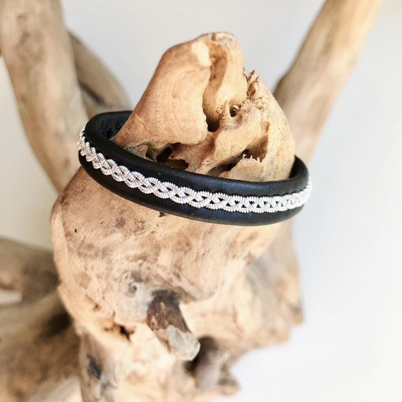 Traditional Sami black reindeer leather bracelet with flat pewter and a tree of life pewter button.