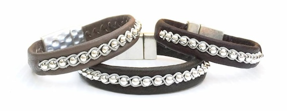 Scandinavian leather bracelets with sterling silver beads in a row braid.