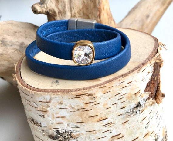 Blue wrap around reindeer leather bracelets with a magnetic clasps.