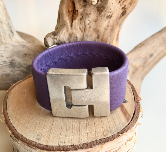 Purple reindeer leather cuff with a magnetic clasp.