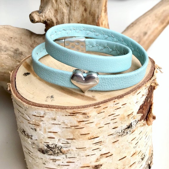 Light aqua wrap around reindeer leather bracelets with a magnetic clasps.