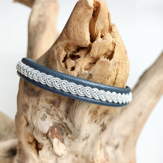 Sami traditional charcoal blue reindeer leather bracelet with an antler button.
