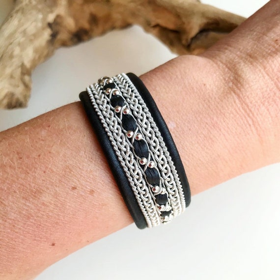 Wide black reindeer leather bracelet with traditional pewter braiding, sterling silver beads and twisted borders.