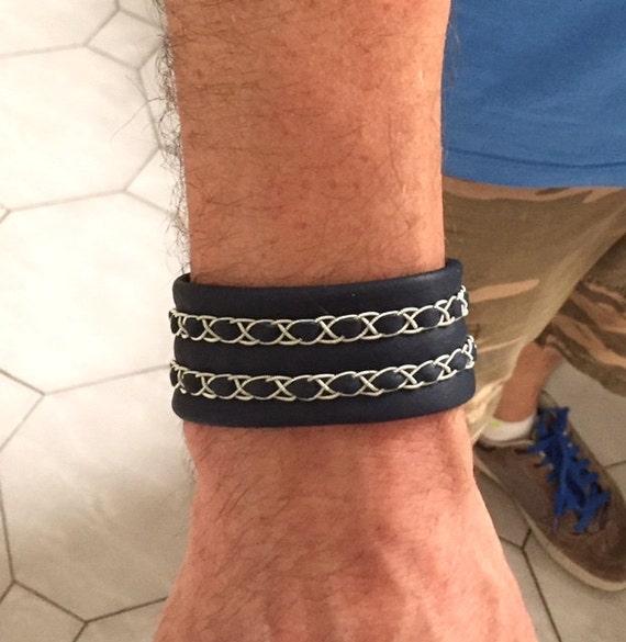 Scandinavian bracelet with thin Sami braids on a reindeer leather cuff.