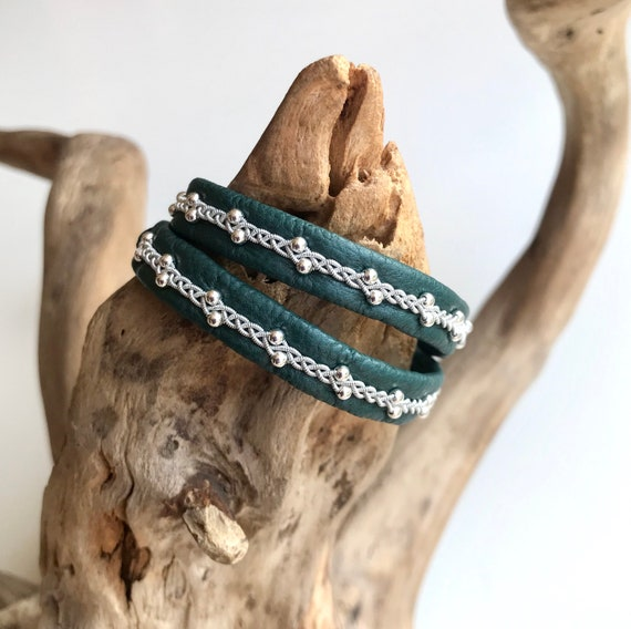 Sami double leather bracelets with sterling silver beads.