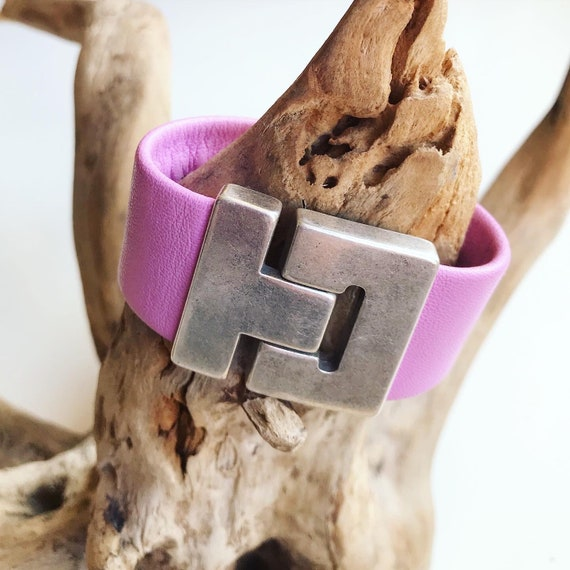 Pink reindeer leather cuff with a magnetic clasp.