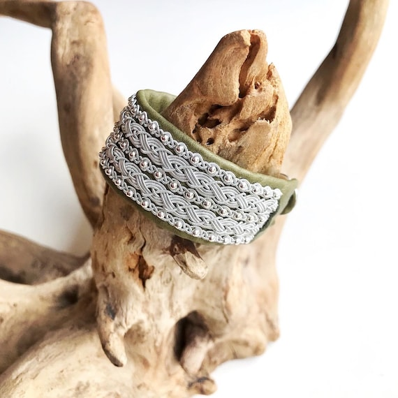 Olive shimmery leather cuff, with pewter threads braids and sterling silver beads.