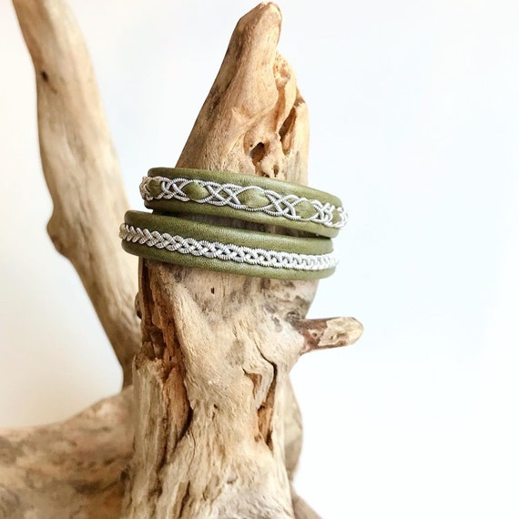 Traditional Sami reindeer leather and pewter bracelets in a shimmery light olive.