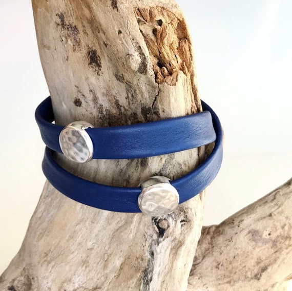 Wrap around reindeer leather bracelet with a magnetic clasp and two dimpled disc silver sliders.