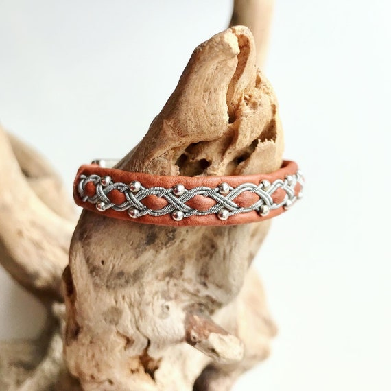 Sami tan reindeer leather bracelet with pewter and sterling silver beads and a magnetic clasp.