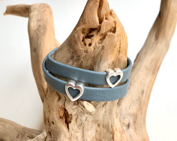 Grey blue wrap around reindeer leather bracelet with a magnetic clasp and two heart sliders.