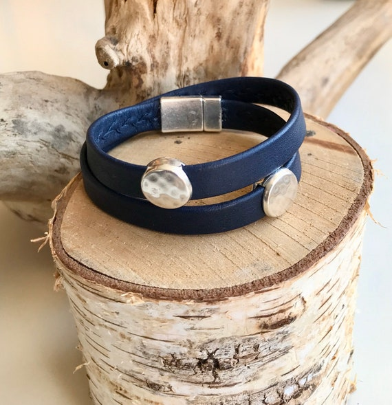 French navy wrap around reindeer leather bracelets with a magnetic clasp and two sliders.