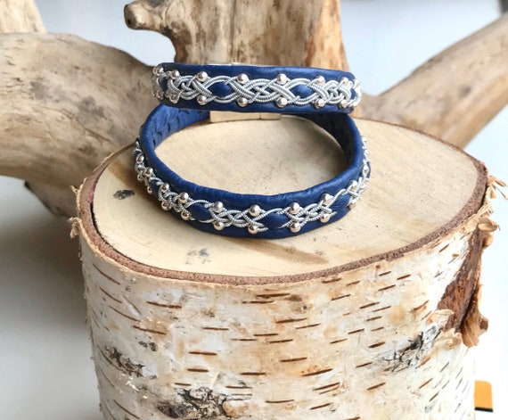 Sami blue reindeer leather, sterling silver beads and pewter bracelets.