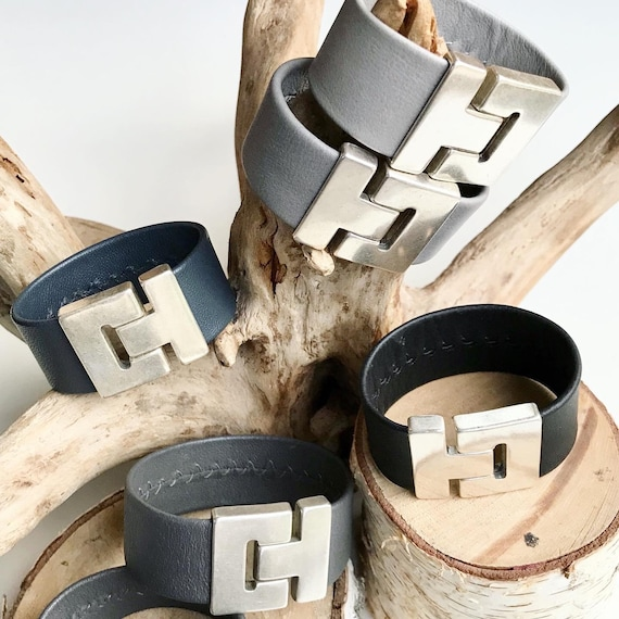 Reindeer leather cuffs in greys and black, with a magnetic clasp.
