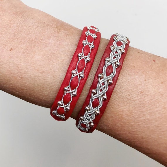 Swedish Sami red reindeer leather bracelets with sterling silver beads.