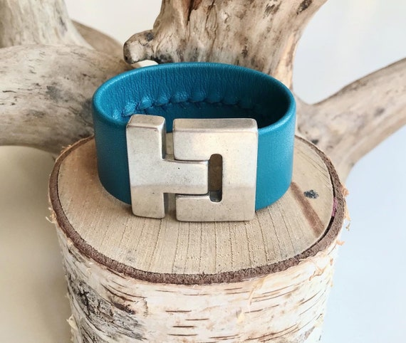 Teal reindeer leather cuff with a magnetic clasp.