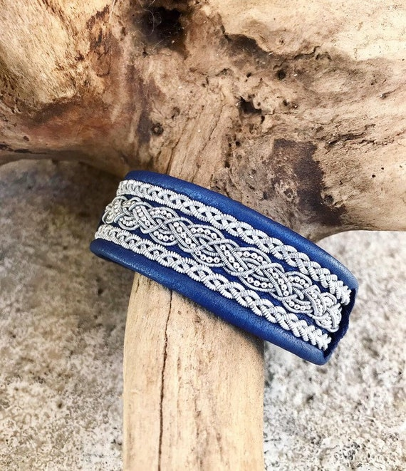 Scandinavian blue reindeer leather bracelet with flat pewter braid borders. and sterling silver bead chain.