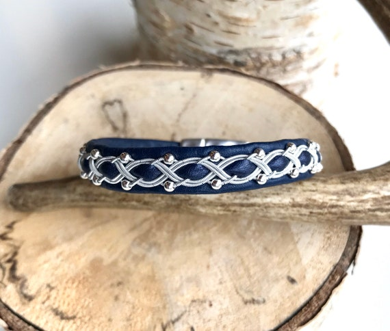Navy reindeer leather bracelet with traditional pewter braiding and sterling silver beads.