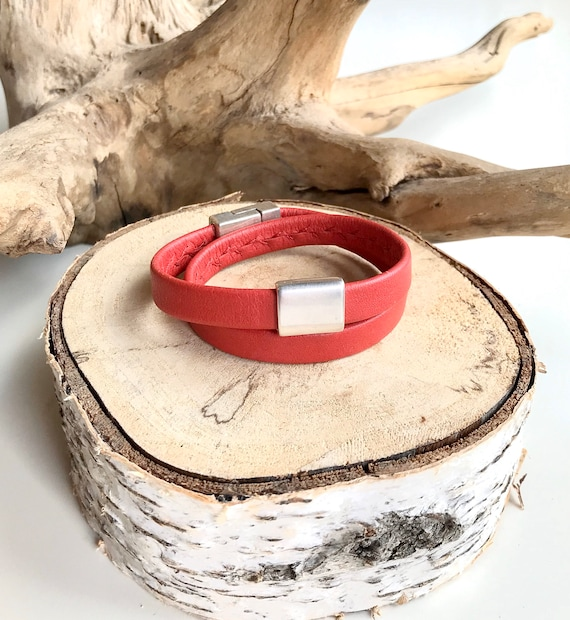 Red wrap around reindeer leather bracelet with a magnetic clasp and a silver rectangular slider.