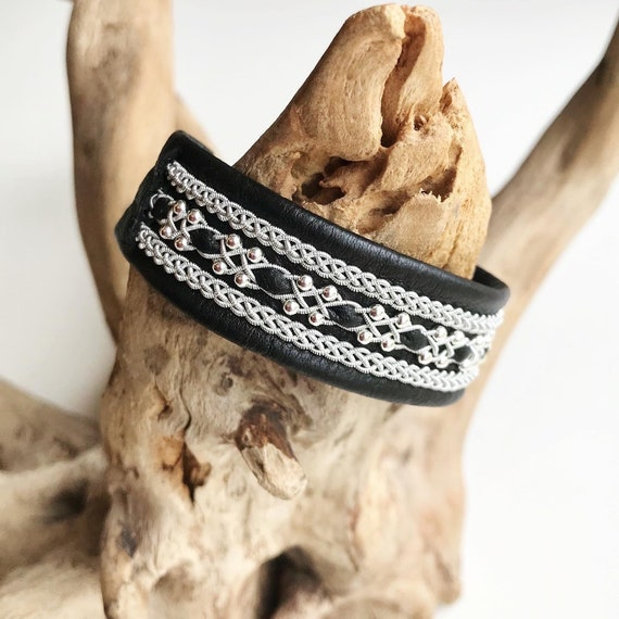 Wider black reindeer leather bracelet, with pewter threads braids and sterling silver beads.