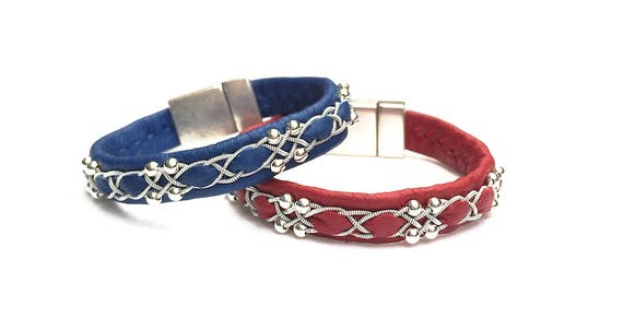 Viking reindeer leather bracelets with sterling silver beads.