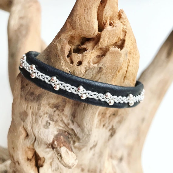Sami black reindeer leather, pewter and sterling silver beads bracelet with a magnetic clasp.