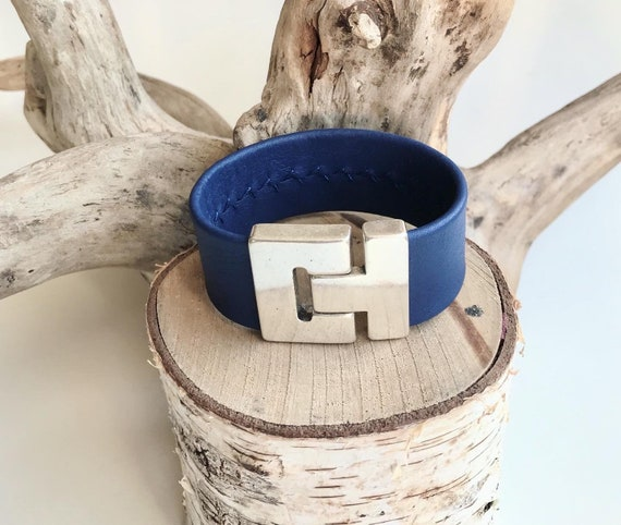 Blue reindeer leather cuff with a magnetic clasp.