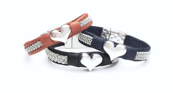 Scandinavian Sami  leather bracelets with heart or daisy centre piece.