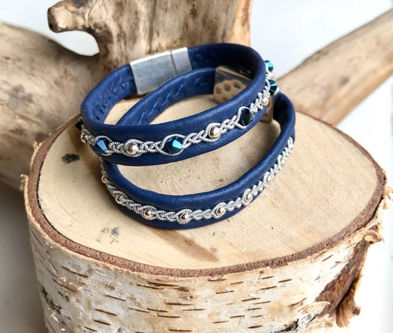 Sami blue reindeer leather, row of sterling silver beads and pewter bracelets.