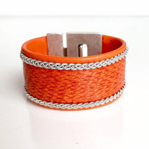 Wide orange salmon and reindeer leather cuff bracelet, with a magnetic clasp and pewter braids.