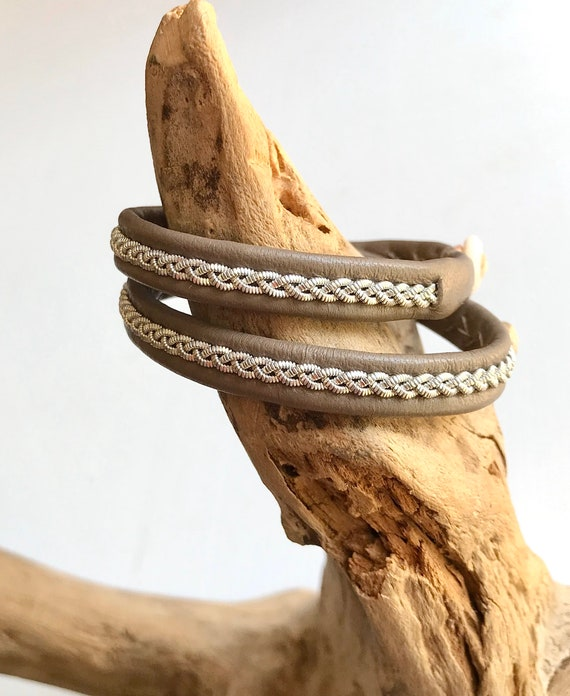 Traditional Sami reindeer leather bracelets, in taupe with a braid of flat pewter threads.