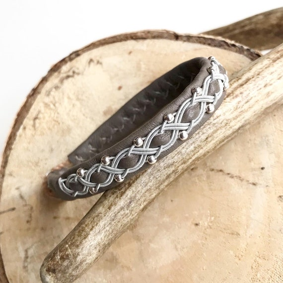 Latte reindeer leather bracelet with traditional pewter braiding and sterling silver beads.