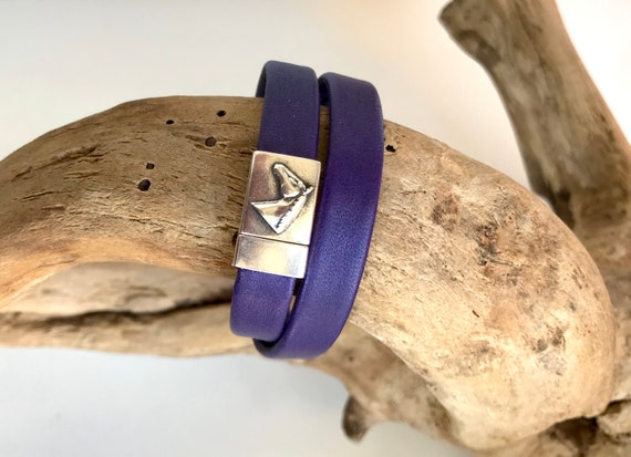 Purple reindeer leather wrap around bracelets with a horse magnetic clasp.