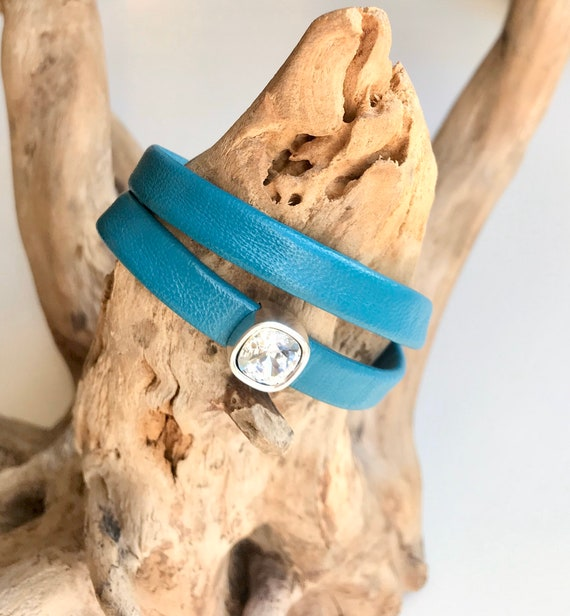 Wrap around teal reindeer leather bracelet with a magnetic clasp and Swarovski slider.