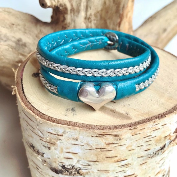 Teal traditional Sami reindeer leather bracelet, with a braid of flat pewter threads and a silver heart.