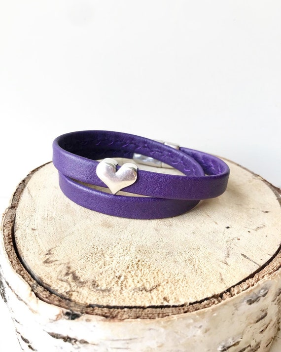 Purple wrap around reindeer leather bracelet with a magnetic clasp and silver heart.